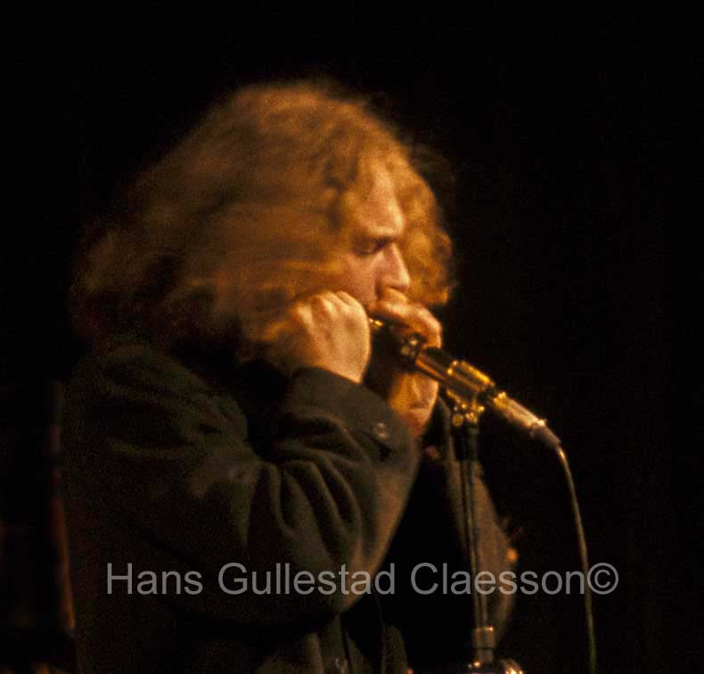A close up of Ian Anderson playing the harmonica at Stockholm Konserthus 9/1/69